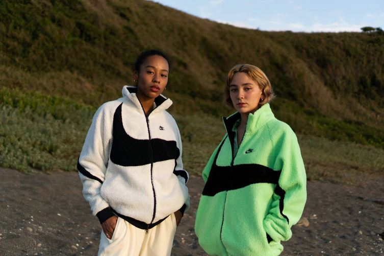 Two models wearing Nike's New Jacket Series
