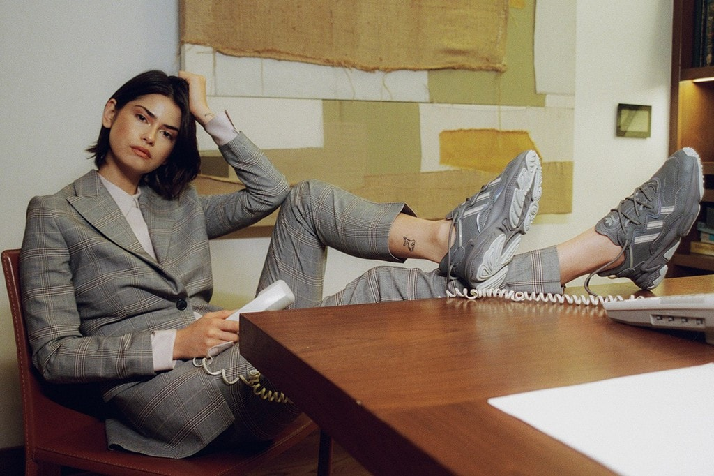 Young woman in an elegant power suit and matching sneakers