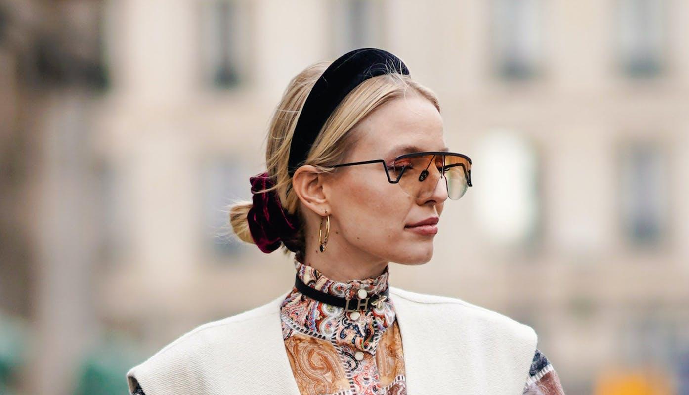 Woman waring a black velvet headband