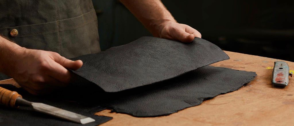 Man working with a sheet of Mylo leather