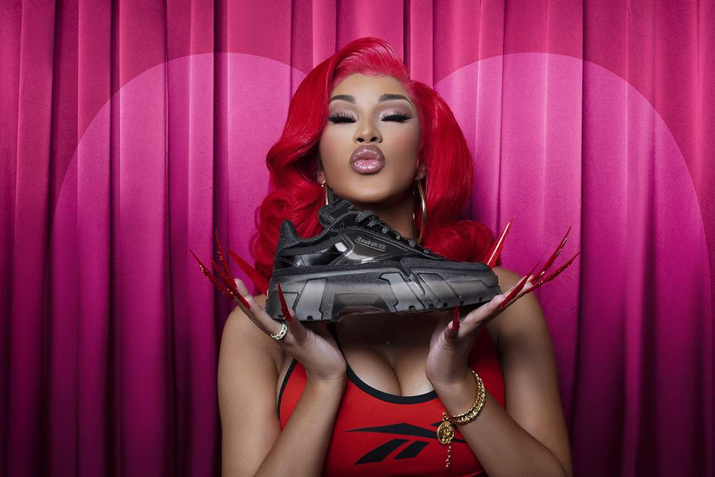 Cardi B Posing With Her Reebok Sneaker