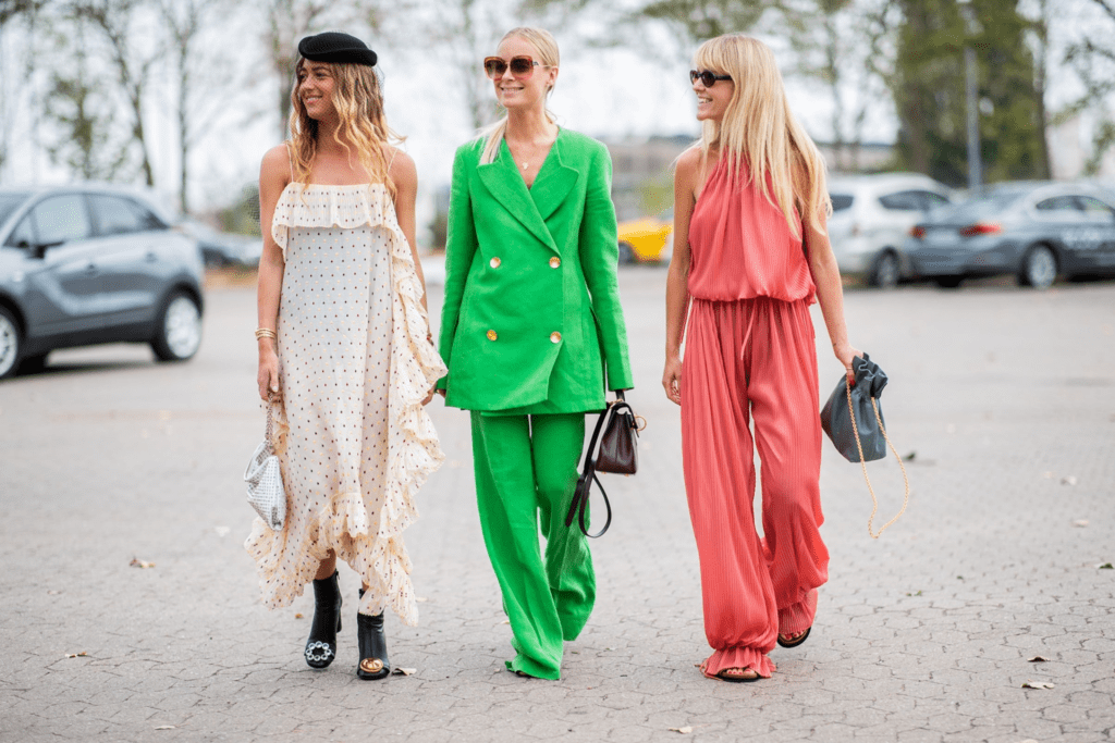 Three young women on the street in stylish clothing