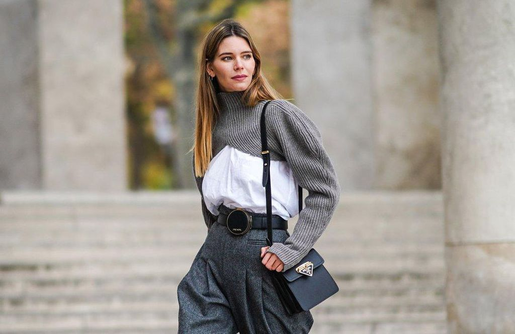 Woman wearing a stylish outfit outdoors with a shrug sweater