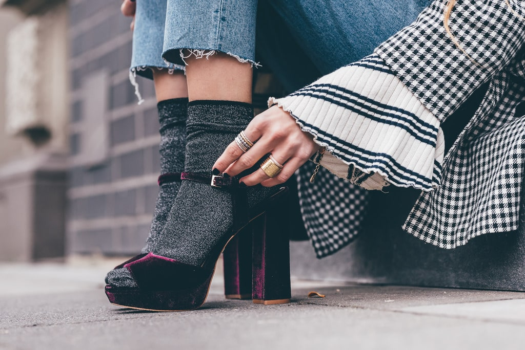 girl wearing socks inside spring heels