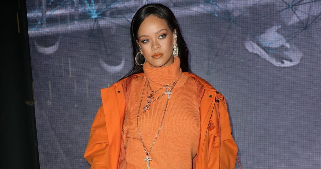 Rihanna wearing a monochrome outfit in orange