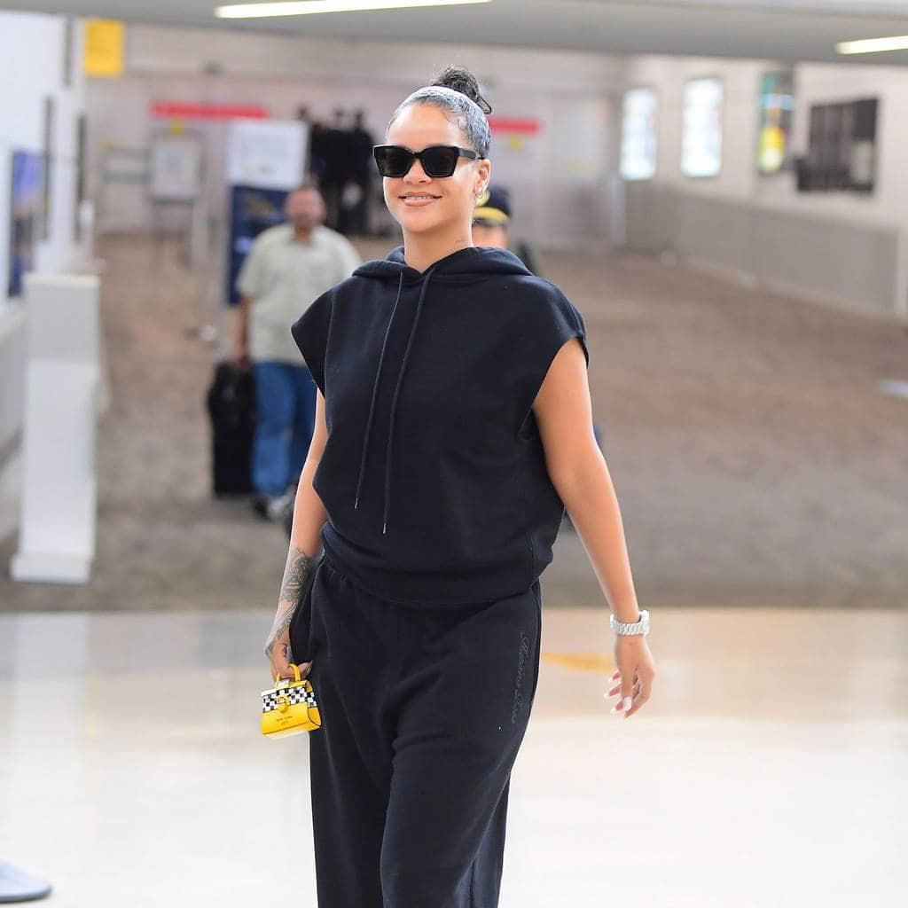 Rihanna sporting a yellow mini bag