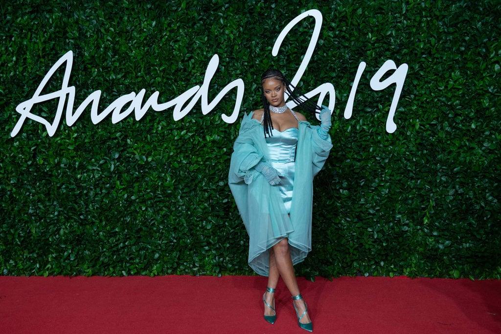 Rihanna wearing a light blue outfit at an event