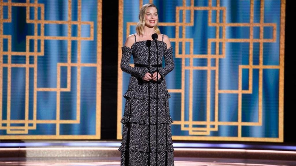 Margot Robbie shows off her Chanel outfit from head to toe at the 2021 Golden Globes.