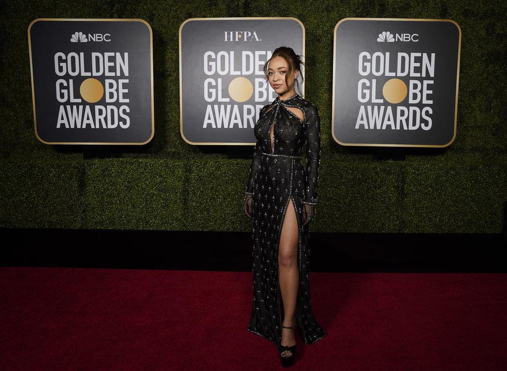 2021 Golden Globes ambassador, Satchel Lee, showing off her Gucci gown on the red carpet.
