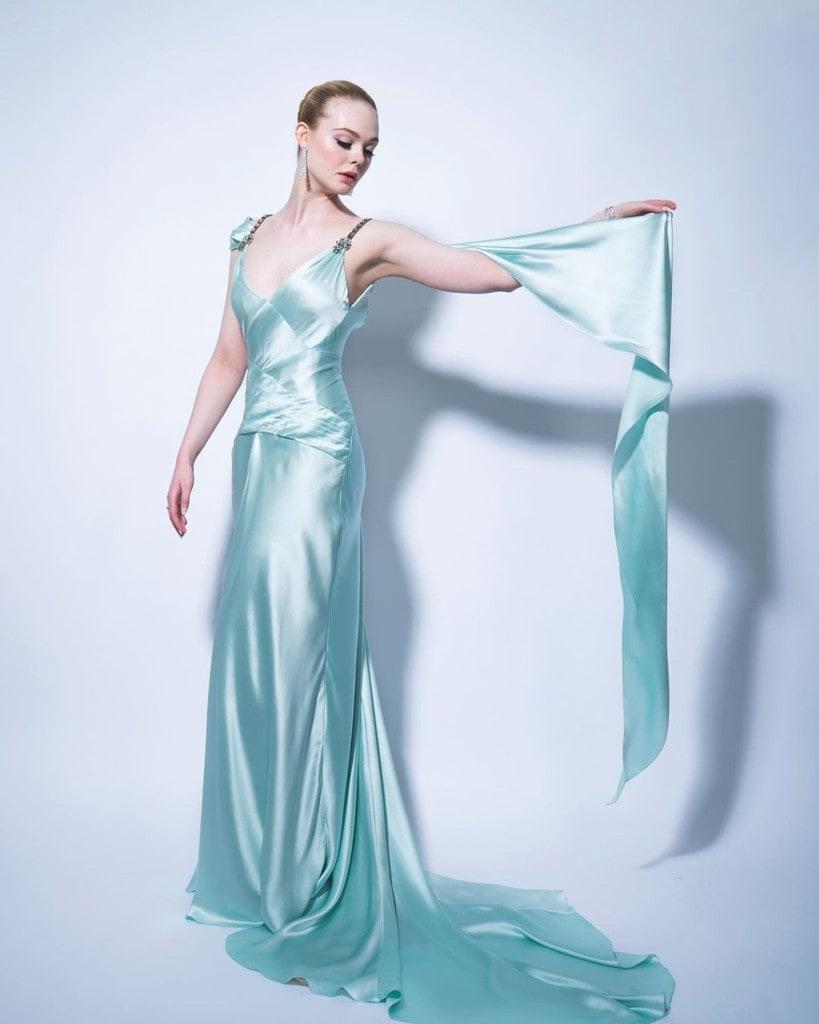 Elle Fanning posing in a Gucci dress