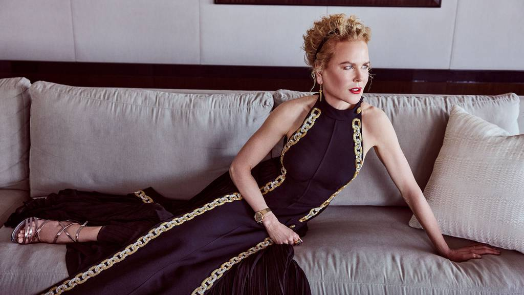 Nicole Kidman posing on a couch in a Louis Vuitton gown