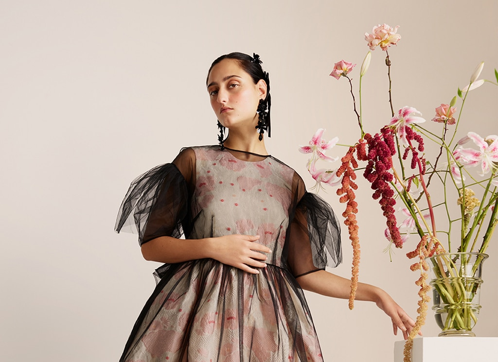 A model wearing a tulle floral dress from the H&M x Simone Rocha collection