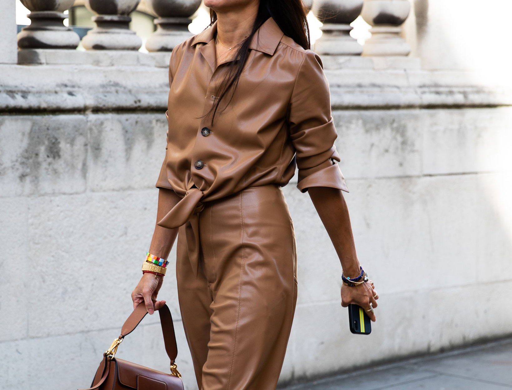Young woman wearing a monochromatic spring outfit - a brown leather bodysuit