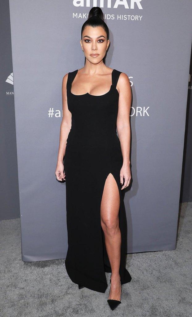 Kourtney Kardashian wearing a black fitted dress for the amfAR gala