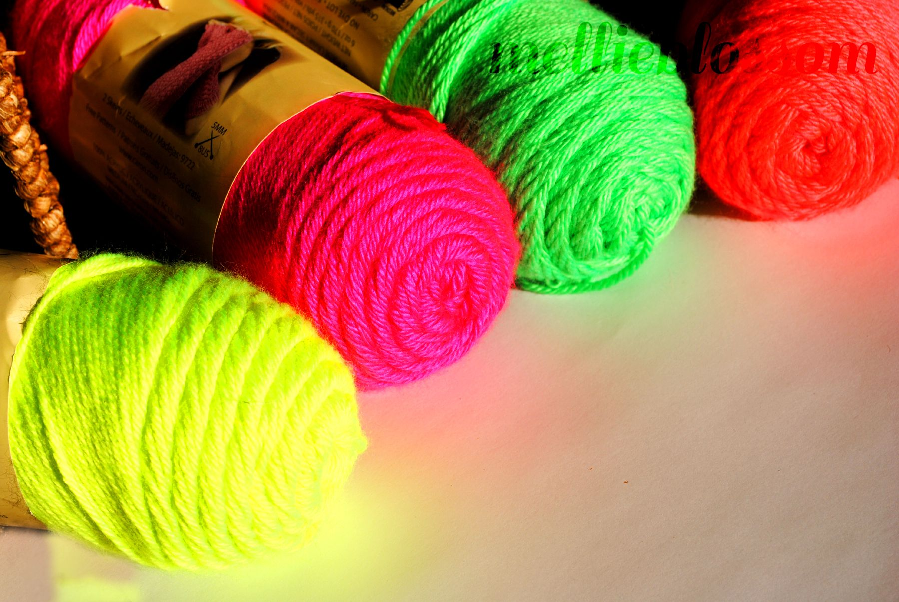 Four colorful bundles of knitting strings