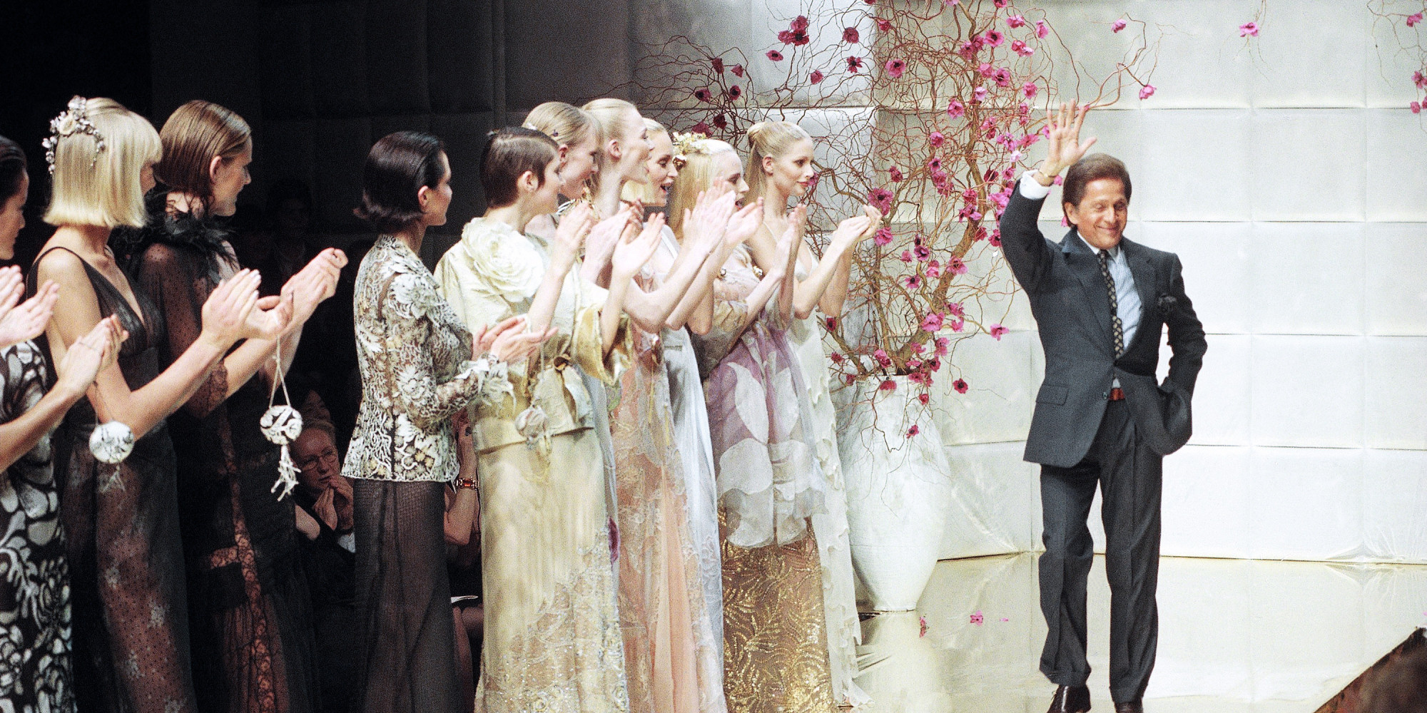 Valentino Garavani walking out on the runway after a fashion show of his house, waving at the audience